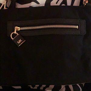 A brand new Michael Kors crossbody bag